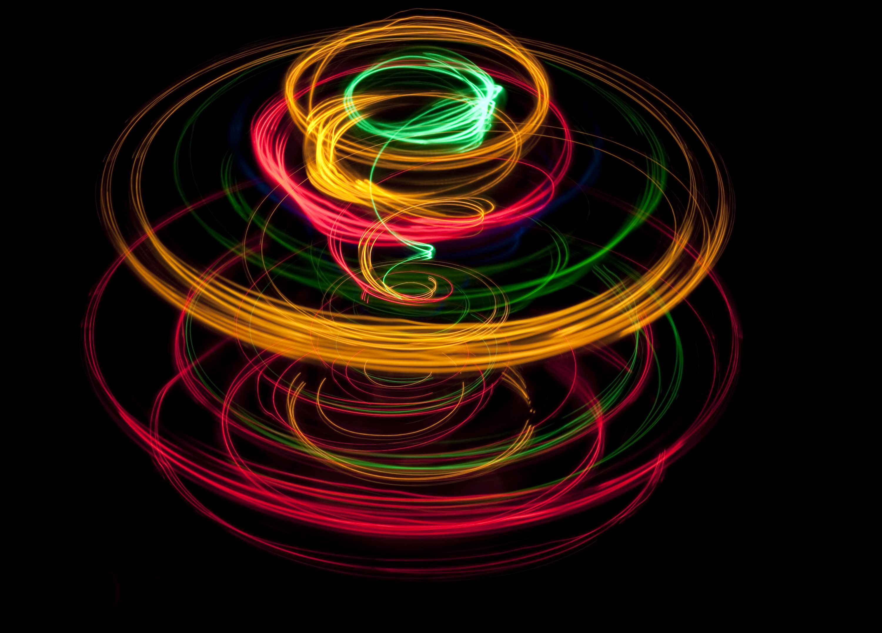 glowing lines of light plotting a spiraling circular pattern